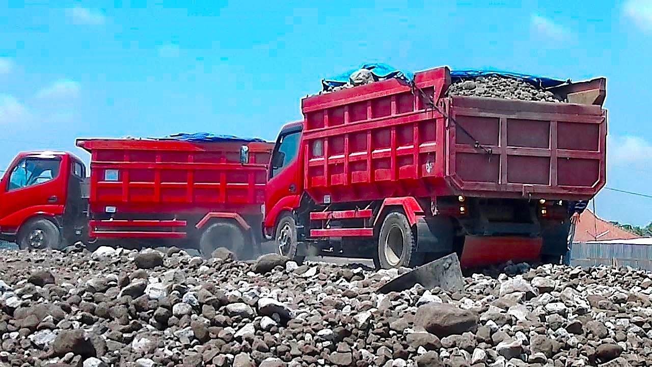 Isuzu Mitsubishi Dump Truck Unloading Gravel From Their Garage Depot