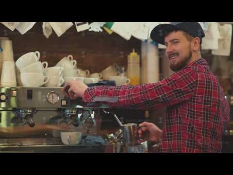 The culture of coffee. Barista makes a cup of coffee for the visitor