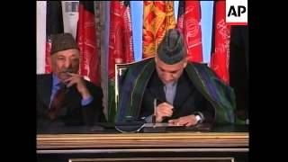 Karzai signs new constitution