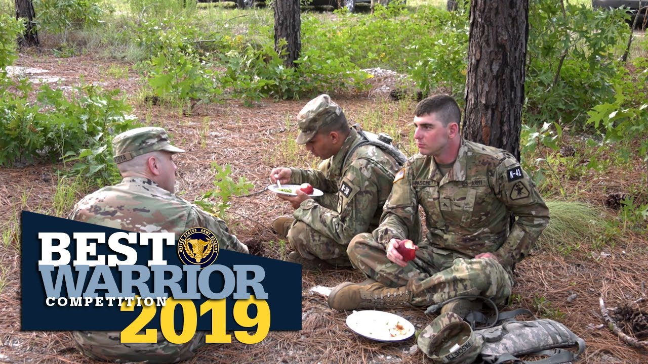 Command sergeants major serve a meal in a show of appreciation for the hard work of the competitors in the 2019 U.S. Army Reserve Best Warrior Competition.