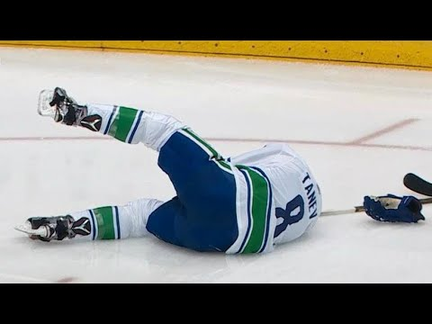 Tanev drops after Marner deflects puck straight to his face