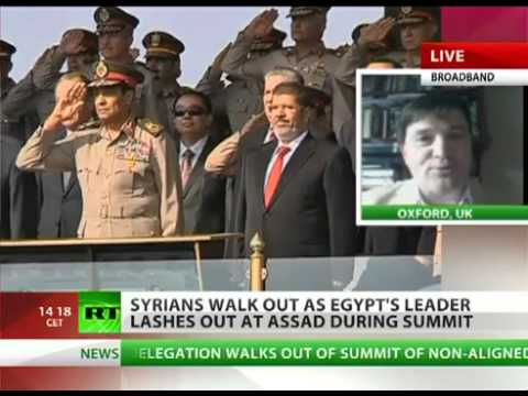 Egypt LEADER Morsi (US PUPPET) lashes out at SYRIA leader ASSAD during IRAN NAM SUMMIT