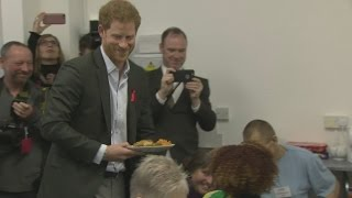 Harry follows in Diana's footsteps by visiting HIV charity