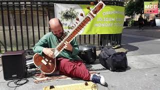 Incredible Brazilian zither player busking in Glasgow