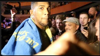ANTHONY JOSHUA NEARLY BREAKS KUGAN CASSIUS' CAMERA WITH PUNCH - AS HE MAKES TIME FOR FANS IN WALES!