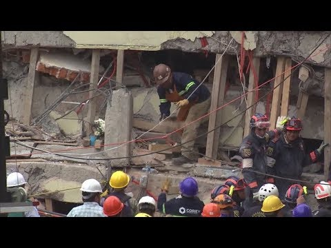 Mexico earthquake rescuers race to free girl, other survivors