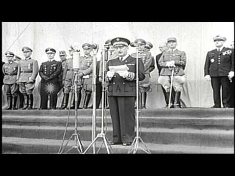 A French official pins medals on German soldiers in Paris, France under German oc...HD Stock Footage