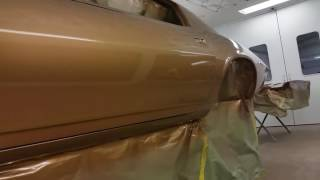 Metalworks Classic Auto Restoration painting a 1970 Z28 camaro in stock Autumn Gold color.