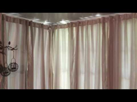 How to Hang Drapes in an Aluminum Sunroom.