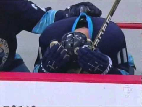 Jordan Staal Gets Andrei Kostitsyn's Stick In The Face From The Bench (March 12 2011)