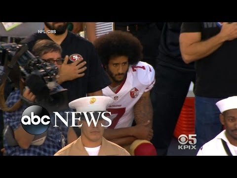 Colin Kaepernick Takes a Knee for National Anthem