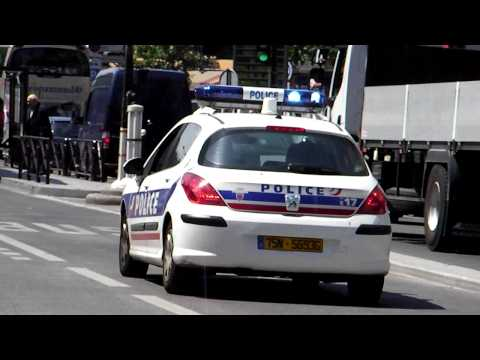 Police Car Responding Lights and Siren in Paris Boulevard Montparnasse