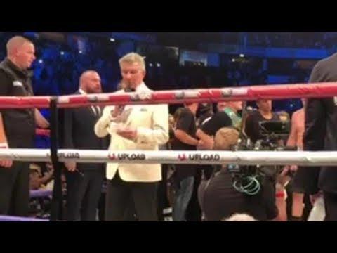 Michael Buffer reads the decision for KSI vs. Logan Paul from ringside