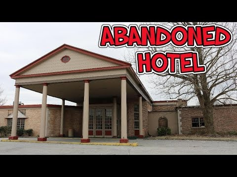 ABANDONED hotel and conference center with indoor pool.