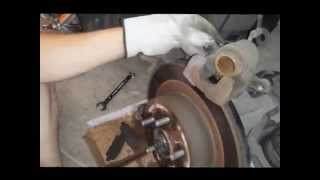 How to Replace rear brakes and rotors - Infiniti G35x 2008. Cute girl helps!