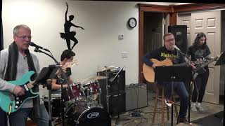 Chris Performing ROCK In The USA Main Street Music and Art Studio
