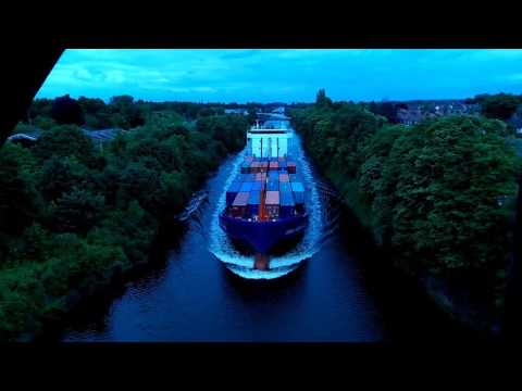 Ship travelling down the Manchester ship canal under cantilever bridge in Warrington