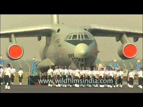 Men of the Indian Air Force march past the Ilyushin IL-76 plane