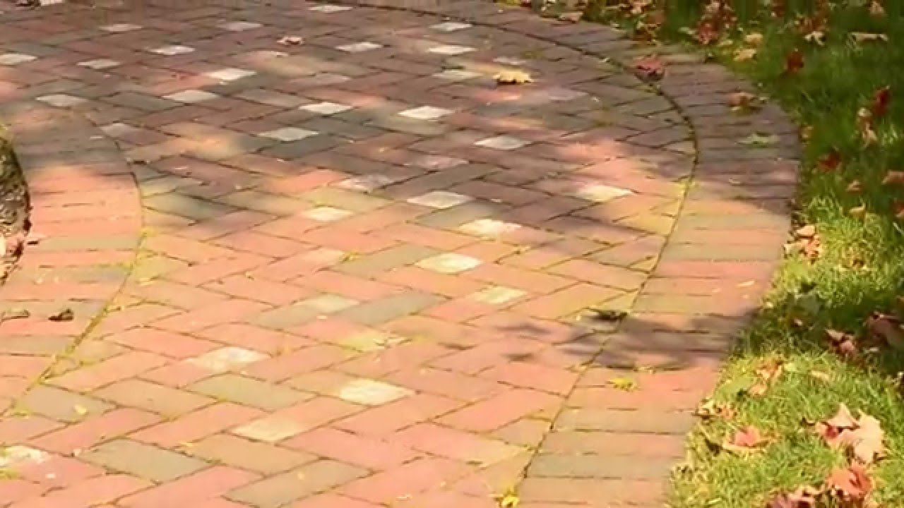 brick paver patio in herringbone