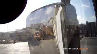 Reverse on dump truck with trailer and  unloading