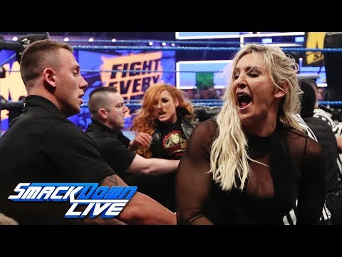 Becky Lynch and Charlotte Flair brawl on \
