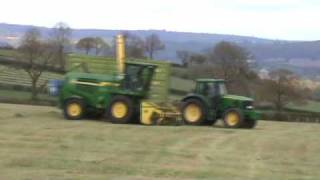 Silaging with a Deere - 7850 races the tractors!