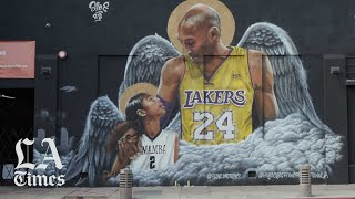 Fans visit Kobe murals a year after his death with Mamba Mentality: don't take life for granted