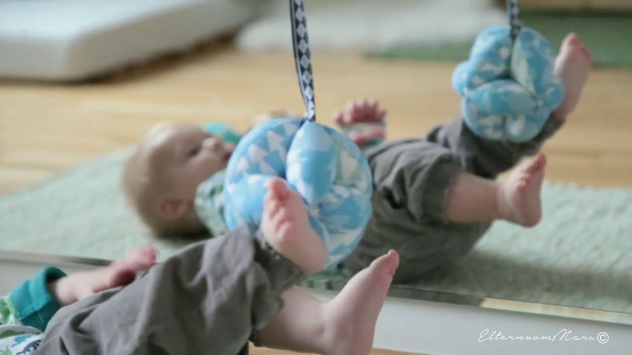 Jakob and the Montessori puzzle ball (7 months old)