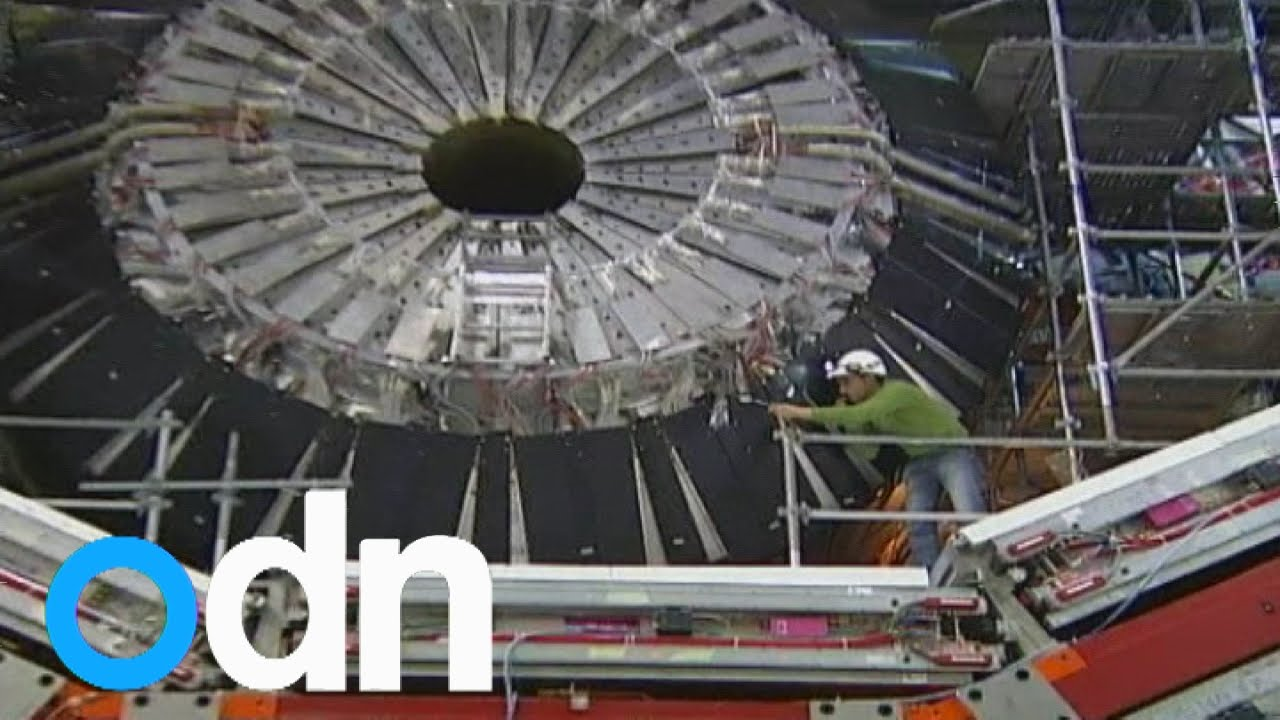 Atom smashing machine re-starts in dark matter bid - YouTube