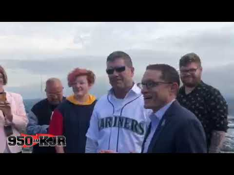 Edgar Martinez Raises the 11 Flag above the Space Needle