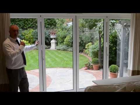 4-Panel bifold doors in white aluminium - YouTube