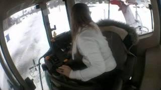 Elise operating a John Deere tractor.wmv
