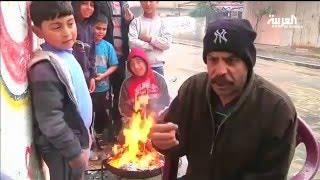 قلة الغاز وموجة البرد تفاقم معاناة أهالي غزة