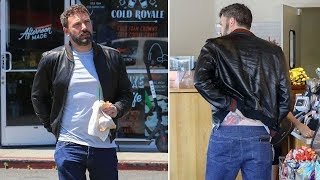 EXCLUSIVE - Ben Affleck Fights A Ruthless Itch On His Lower Back Tattoo