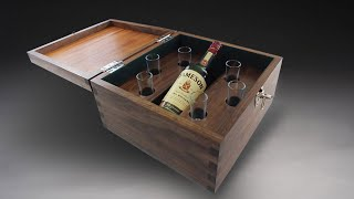 This whiskey box is made from mahogany, walnut and green felt. Custom designed to fit 6 shot glasses. This is available to order