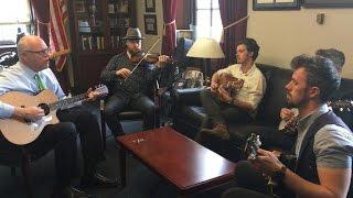 Rep. Crowley plays guitar
