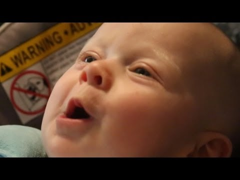 4 month old baby tries to sing to Karen Carpenter song,  Melts Hearts.