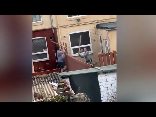 Neighbors battle each other with wood planks!