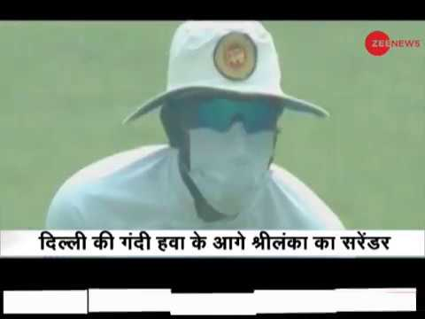 Sri Lankan players wear mask in Feroz Shah Kotla while playing cricket amid smog