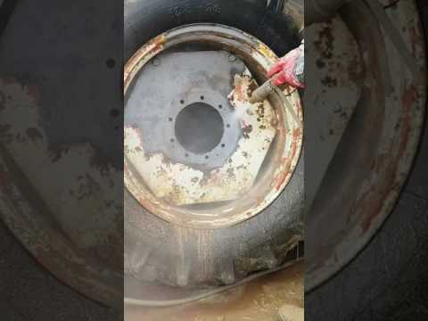 Dustless Blaster removing heavy rust and paint off tractor wheels