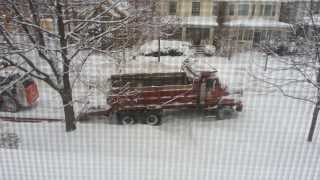 Dump truck stuck in snow pulling trailer