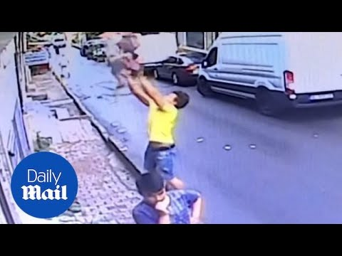CCTV Footage Of Teen Catching Baby After She Falls From Window