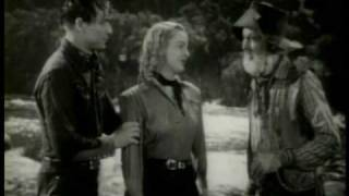 Roy Rogers rescues Dale Evans from a runaway car! ROLL ON TEXAS MOON 1946