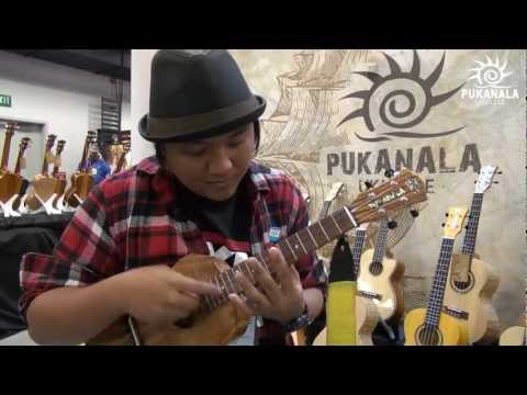 Aldrine Guerrero with PUKANALA ukulele at NAMM 2013