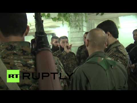 Syria: Shia fighters unite to defend holy shrine