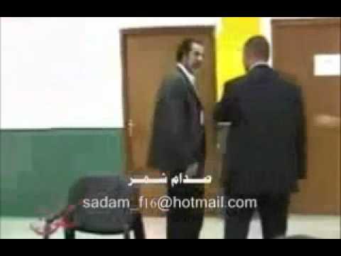 مصور يحاول الاعتداء على صدام حسين ولكن !!.