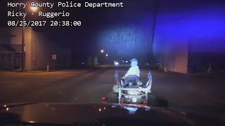 Dashcam Shows Mayor Driving Lawnmower at Night With an Open Container: Cops thumbnail