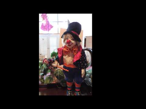Articulated Anomated Porcelain Musical Clown
