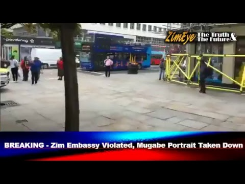 BREAKING - Zim Embassy Invaded By Protesters, Mugabe Portrait Taken Down