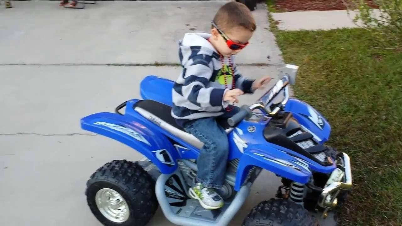 Riding Yamaha Raptor Toy 4 Wheeler Wheels